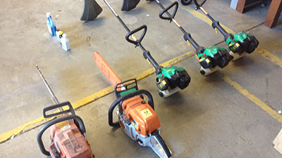 Image shows 5 machines, including weed trimmers and chain saws.